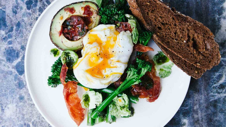 Curried broccoli & boiled eggs on toast